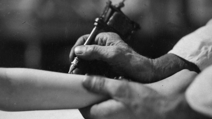 Closeup of a tattooist at work. (Credit: E. O. Hoppe/Mansell/The LIFE Picture Collection/Getty Images)