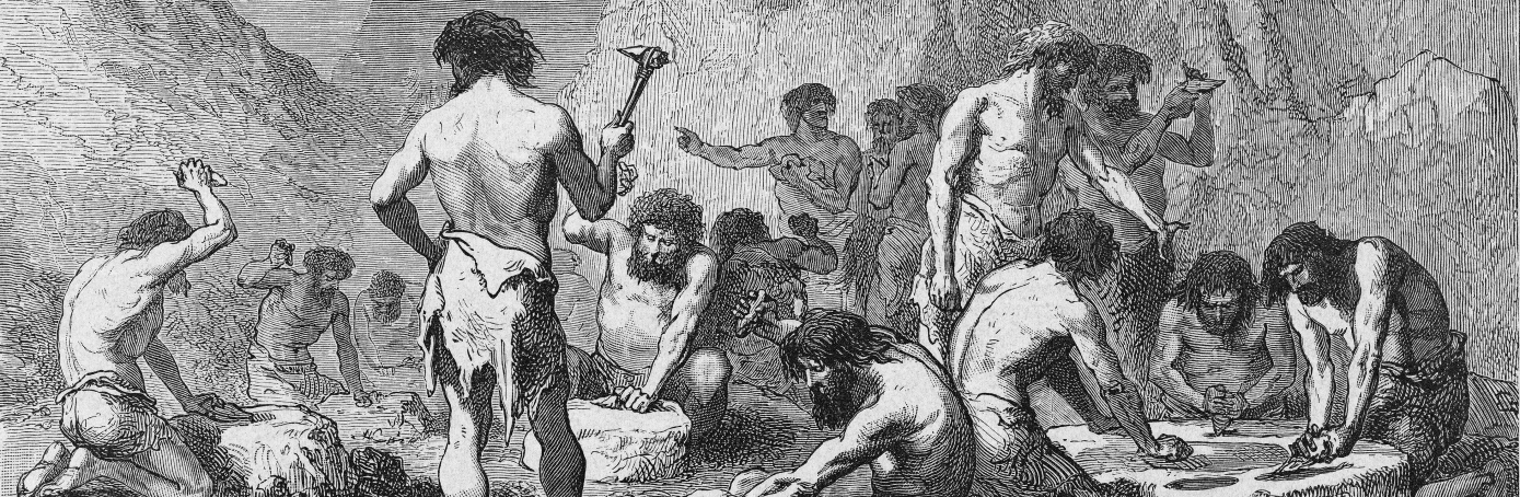 During the Stone Age, a group of men hammer at rock in order to manufacture flints. (Credit: Kean Collection/Getty Images)