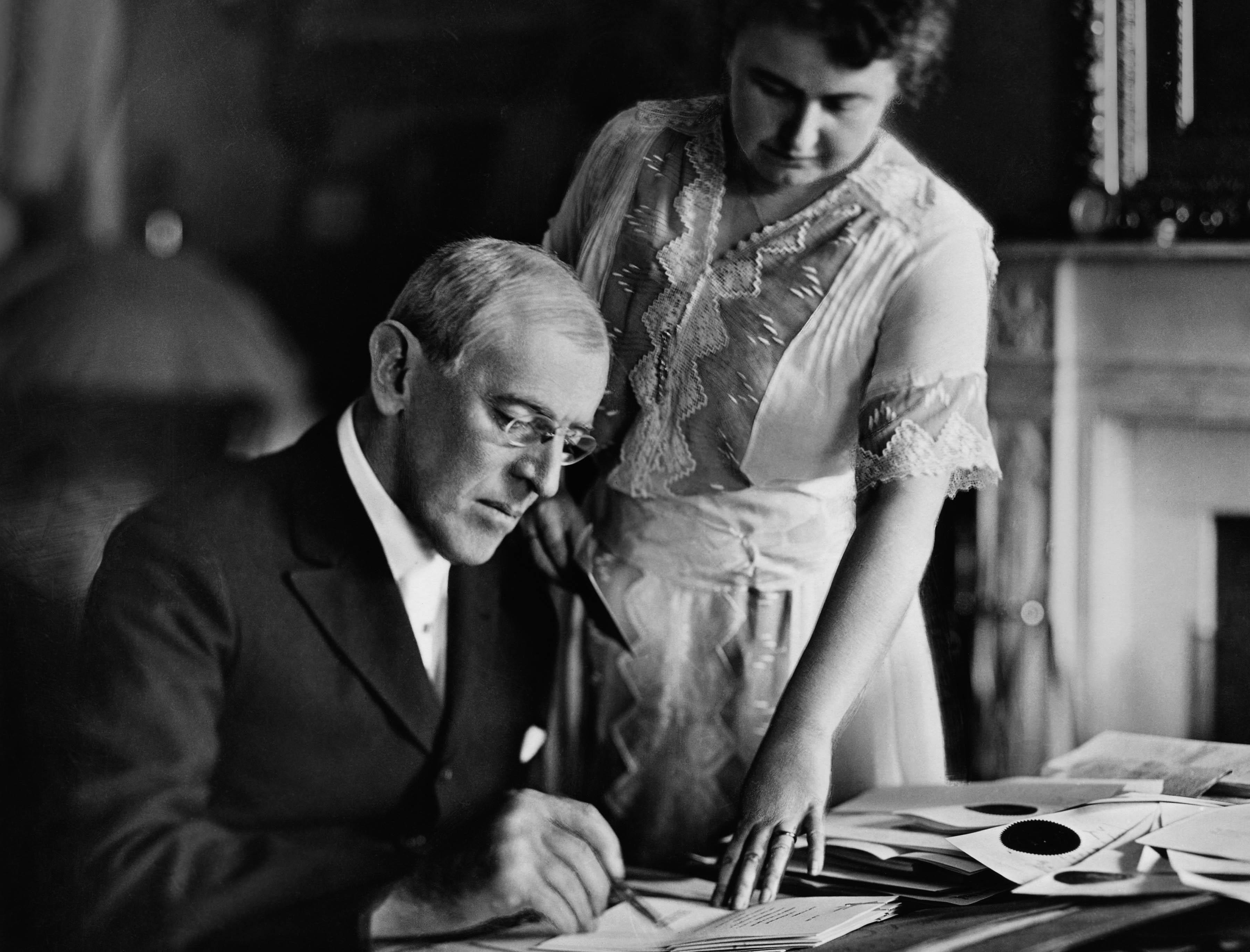 """President Woodrow Wilson with his second wife Edith Bolling Galt Wilson, who was often referred to as """"secret president"""" because of the important role she played in Wilson's presidency during his long and debilitating illness following a stroke. (Credit: Stock Montage/Getty Images)"""