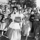 Elizabeth Eckford ignores the hostile screams and stares of fellow students on her first day of school. She was one of the nine negro students whose integration into Little Rock's Central High School was ordered by a Federal Court following legal action by NAACP. (Credit: Bettmann Archive/Getty Images)