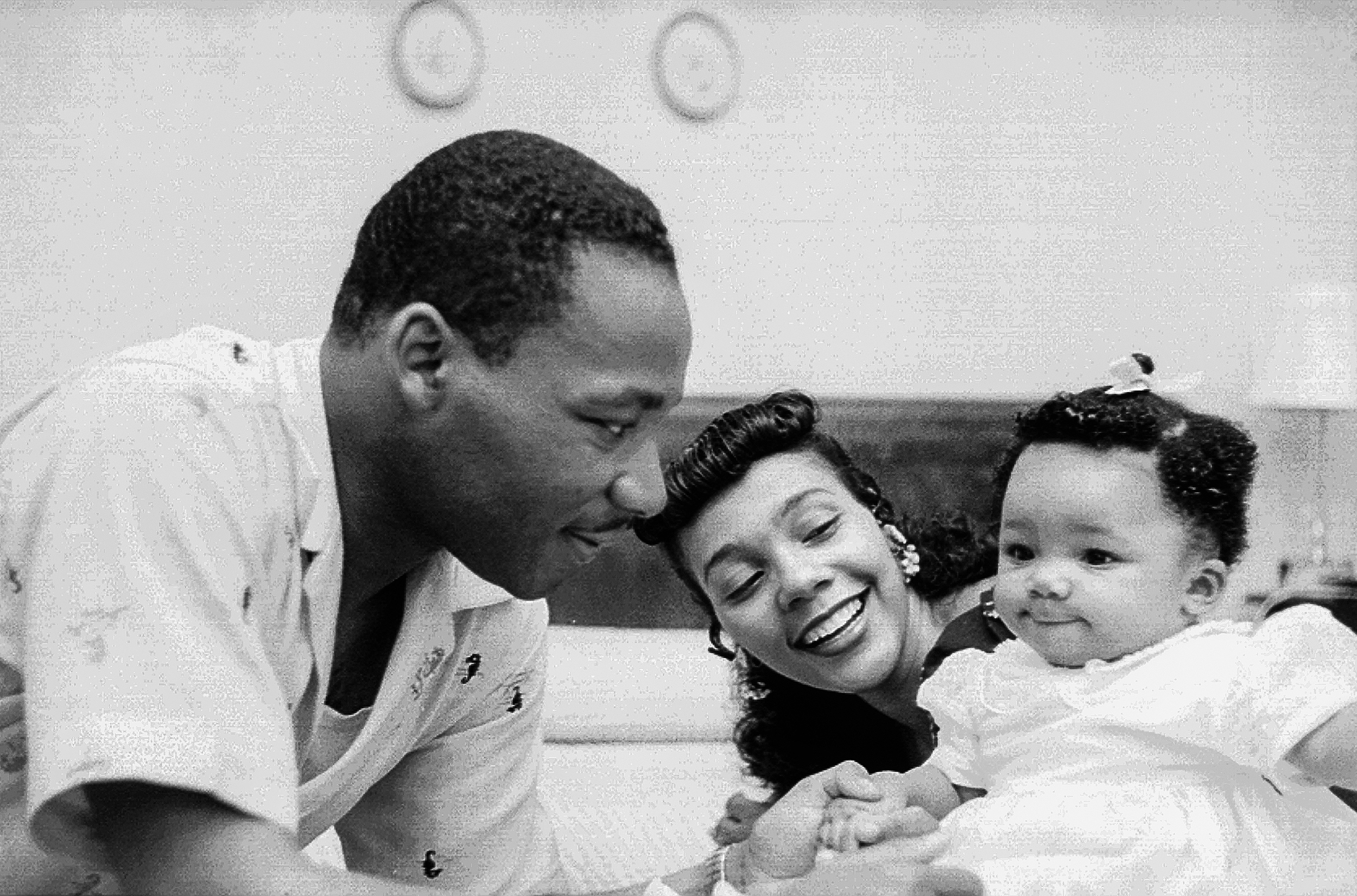 Martin Luther King, Jr. at home with his wife Coretta and first child Yolanda, 1956. (Credit: Michael Ochs Archives/Getty Images)