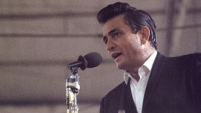 "Country singer Johnny Cash performing for prisoners at the Folsom Prison in California on January 13, 1968. The performance was recorded for his live album ""Johnny Cash at Folsom Prison.""  (Credit: Dan Poush/AP Photo)"