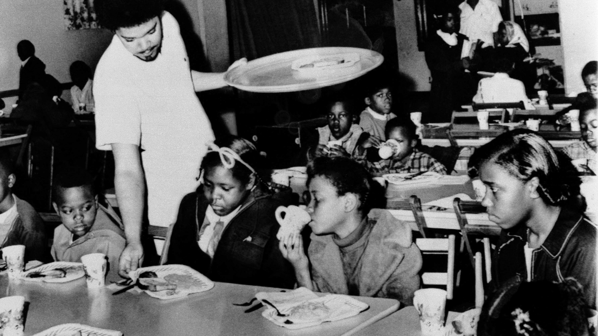 Bill Whitfield, member of the Black Panther chapter in Kansas City, serving free breakfast to children before they go to school. (Credit: William P. Straeter/AP Photo)