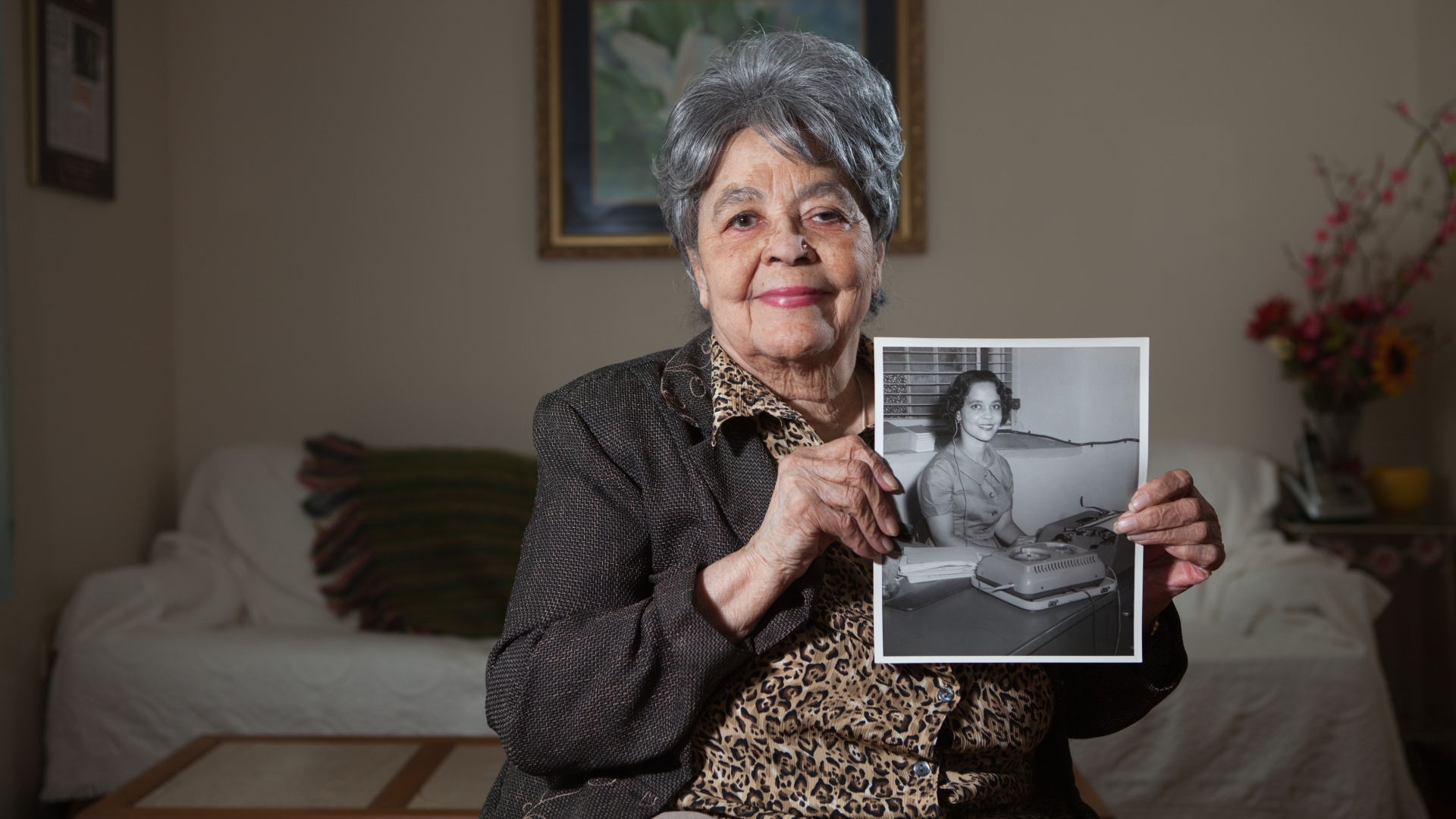 Maude Ballou, in 2015, with a photo of herself taken when she served as Martin Luther King, Jr.'s secretary from 1955 to 1960. (Credit: The Washington Post/Getty Images)