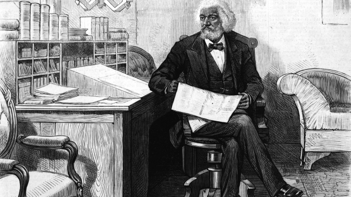 American orator, editor, author, abolitionist and former slave Frederick Douglass, at his desk in the late 1870s. (Credit: Hulton Archive/Getty Images)