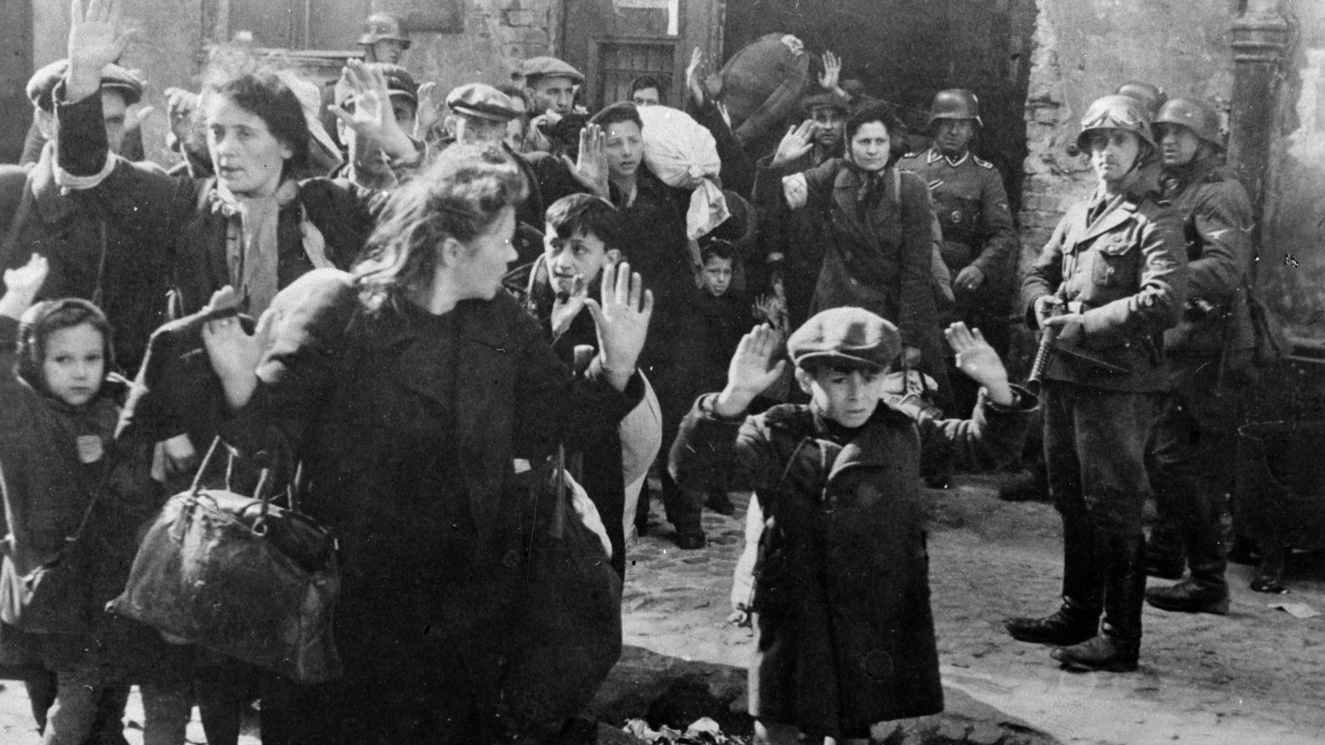 Families being taken out of their house by force of the Germans, in the ghetto of Warsaw, Poland, 1943. (Credit: Roger Viollet Collection/Getty Images)