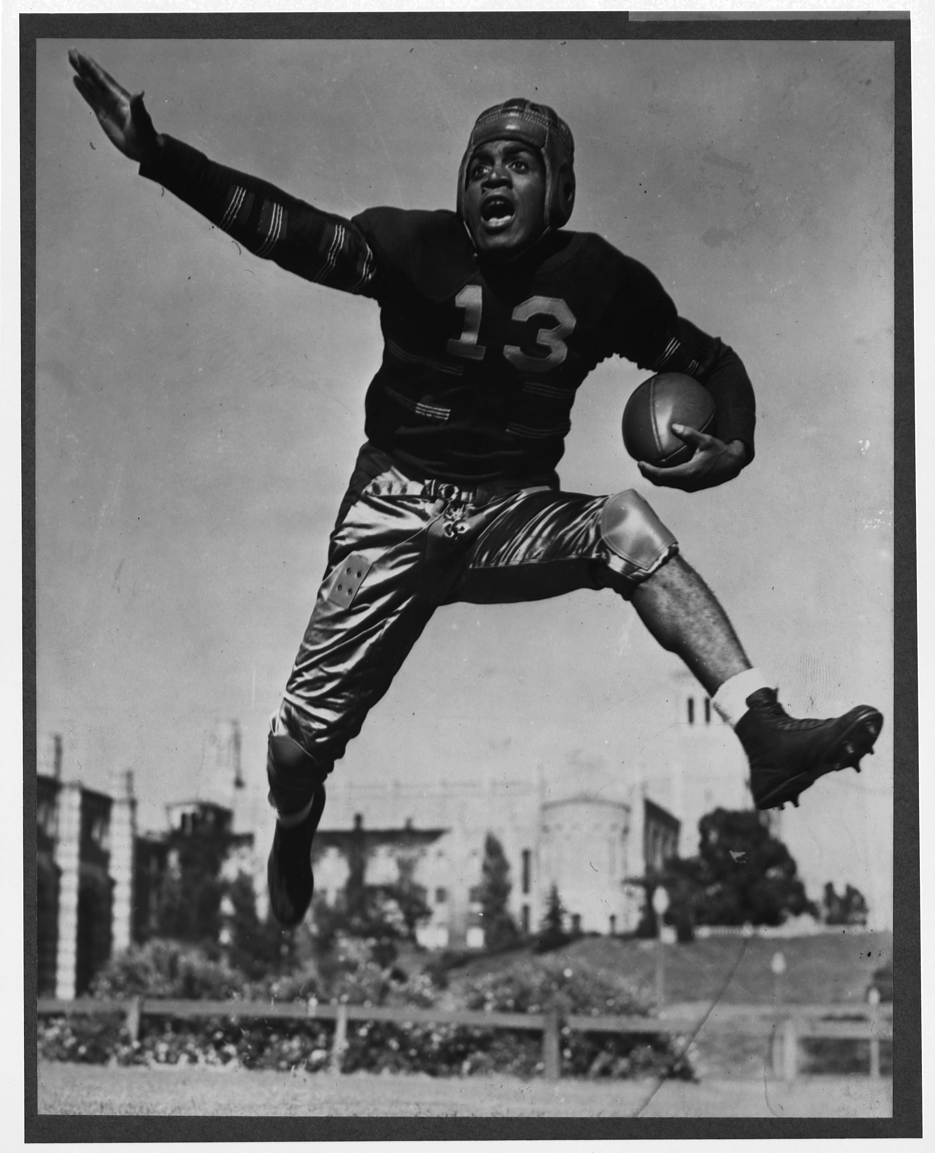 University of California at Los Angeles Bruins football player Kenny Washington leaps high into the air with a football.   (Photo by Library of Congress/Corbis/VCG via Getty Images)