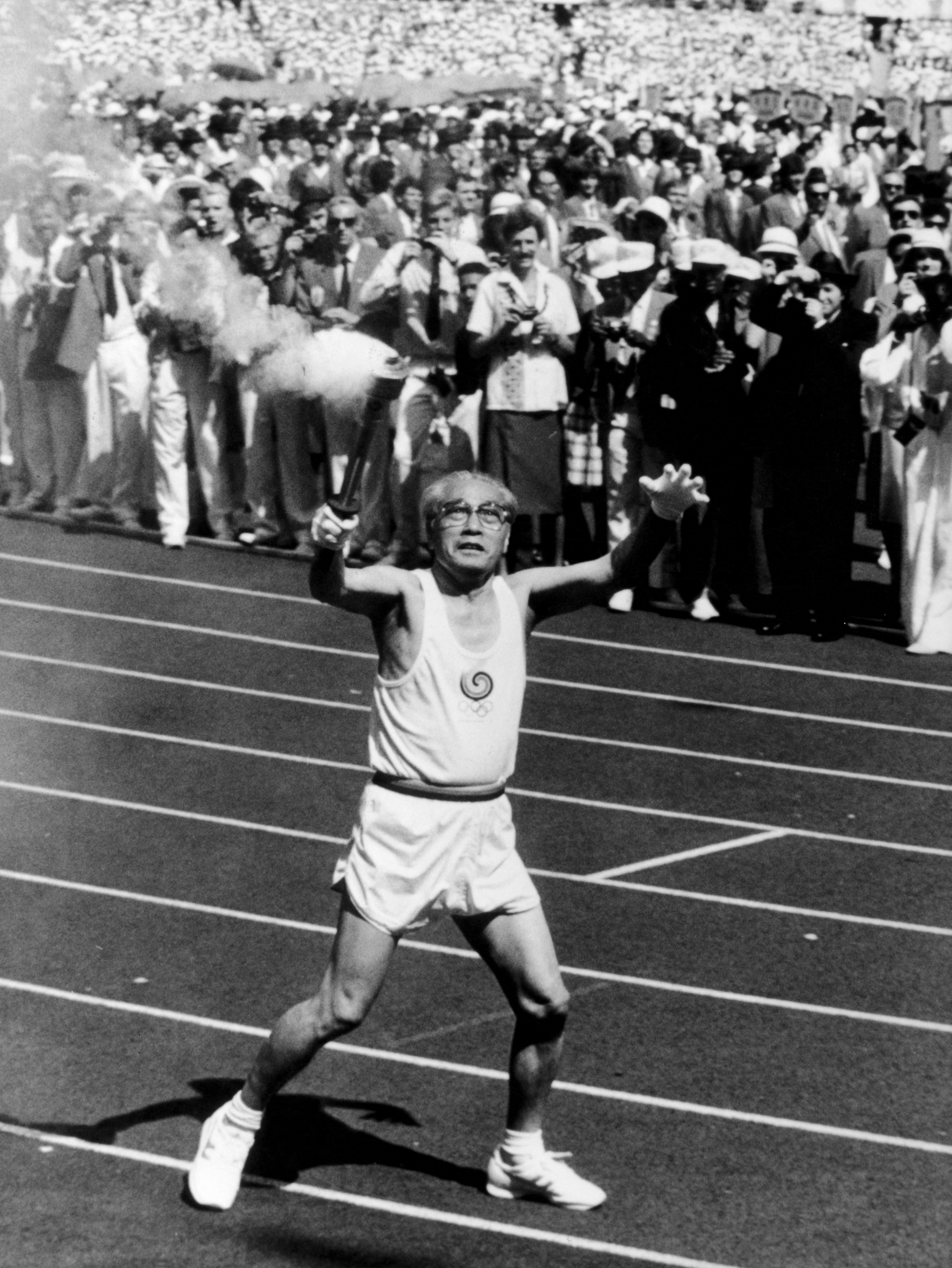 76-year old Sohn Kee Chung, who won the gold medal in the marathon at the 1936 Olympics, carrying the Olympic flame for the 1988 Olympics in South Korea. (Credit: ERMA/Camera Press/Redux)