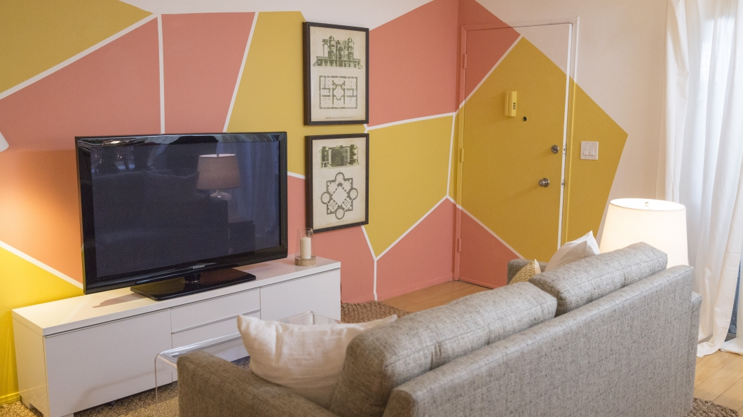 geometric wall design is a unique way to add color and create a modern feel