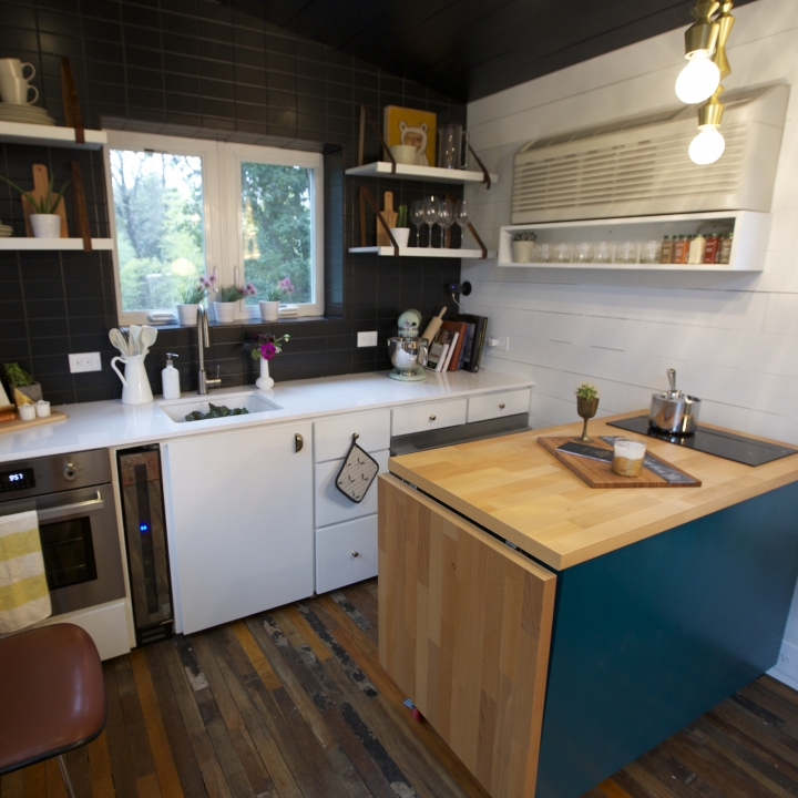 A Miniature Wine Cooler And Collapsable Island Fit Perfectly In The Tiny House Kitchen