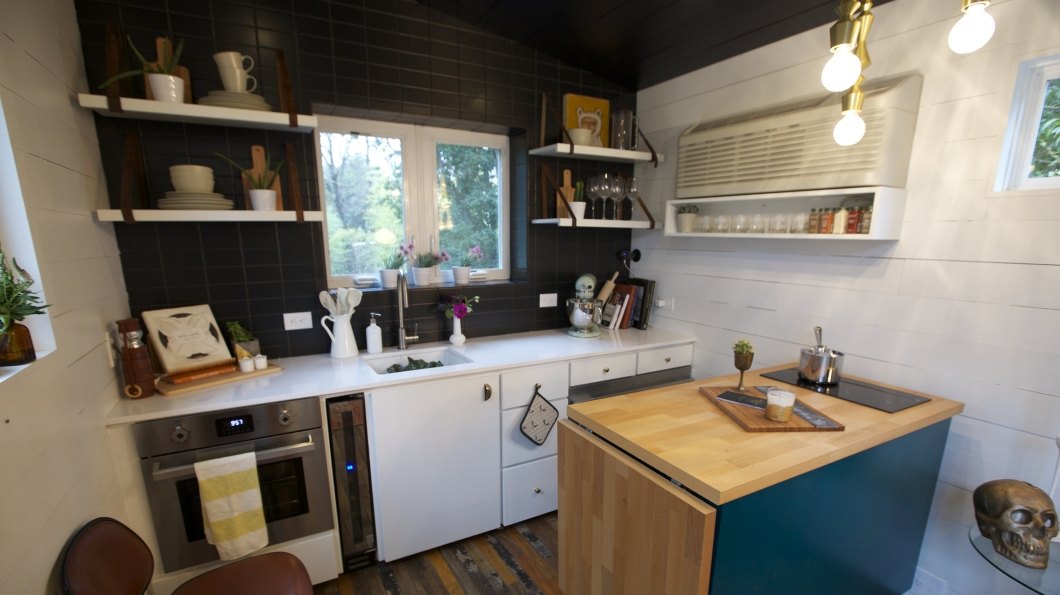 a miniature wine cooler and collapsable island fit perfectly in the tiny house kitchen - Tiny House Kitchen