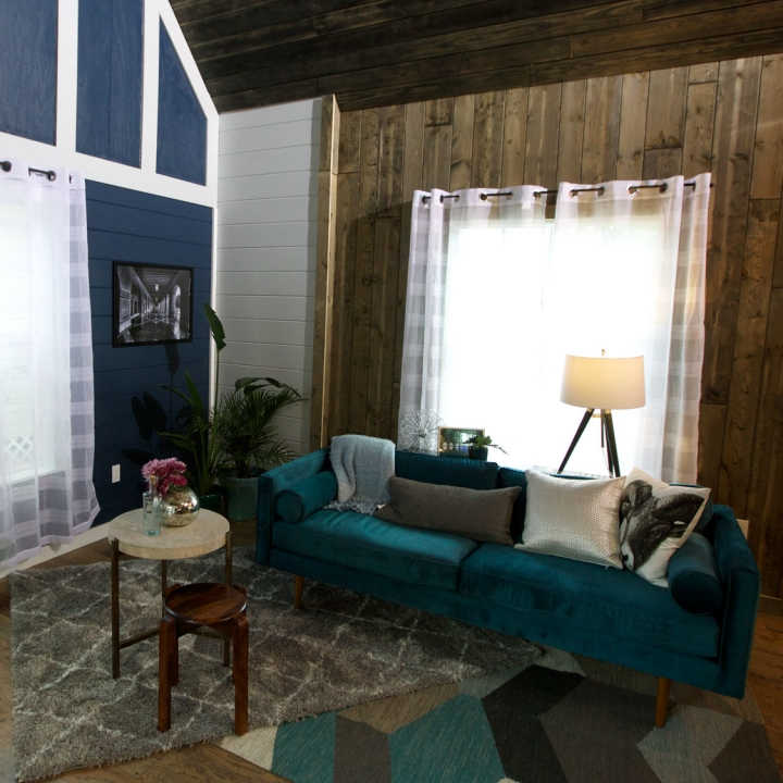 The paneled accent wall in the tiny house added a nice Victorian piece to the living room, while still balancing out nicely with the modern aesthetic of the rest of the room.