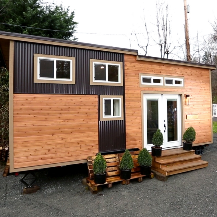 Tiny house nation tiny house tour survival house fyi for Small homes exterior design