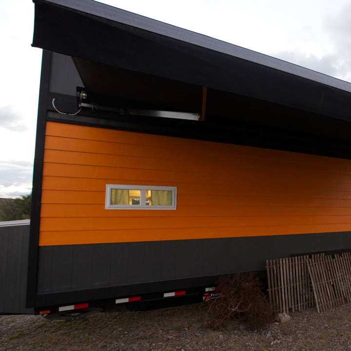 Zach was able to incorporate an extendable garage on the side of the tiny house, specifically for José. And there's a toolbox that fits perfectly under the tiny house too.