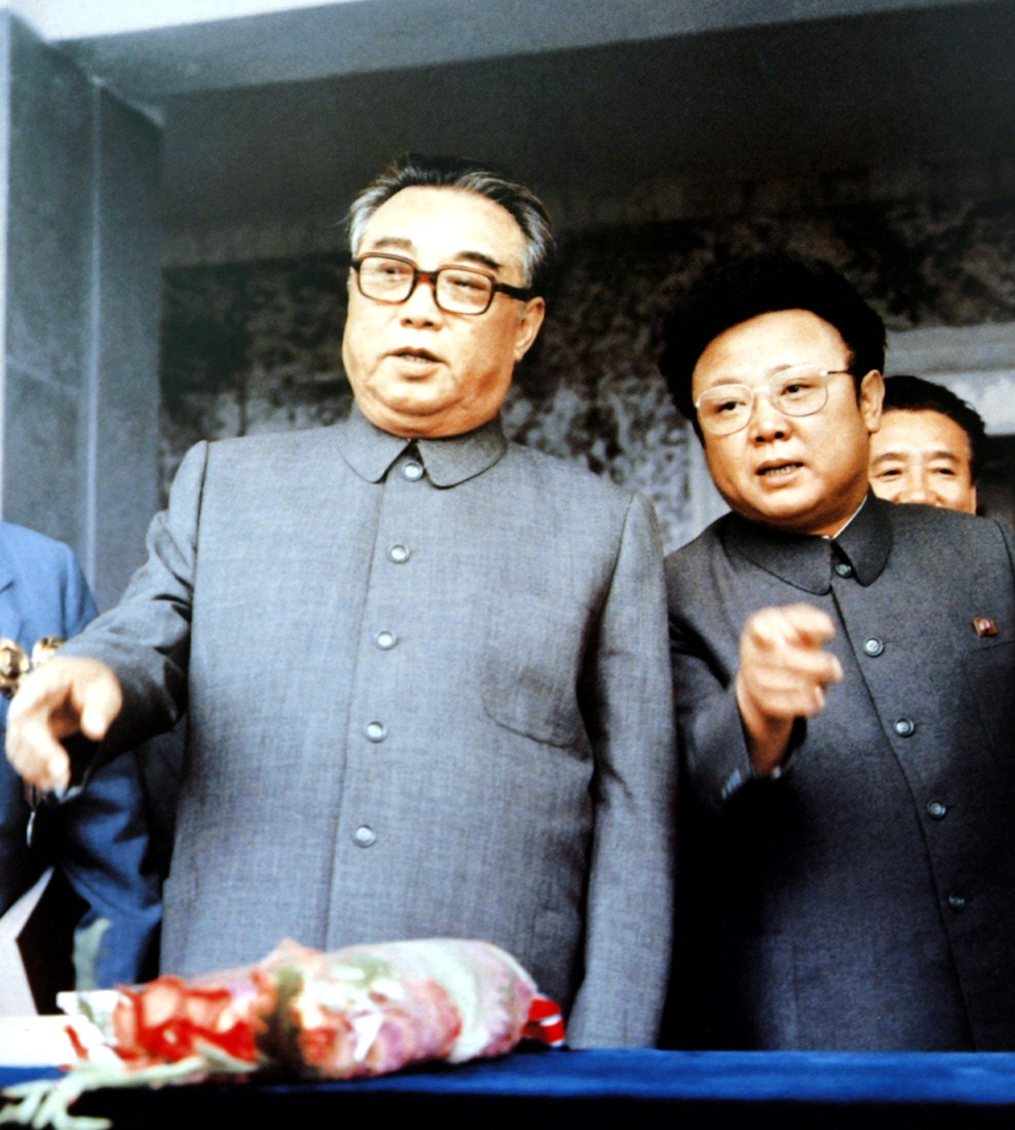 Kim il sung founder of north korea chats with his son kim jong il at kim ii sung communist north korea korean war kim jong ii thecheapjerseys Choice Image