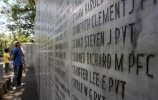 A Filipino looks at the lists of names at the Capas National Shrine to remember those who lost their lives in WWII's Bataan Death March
