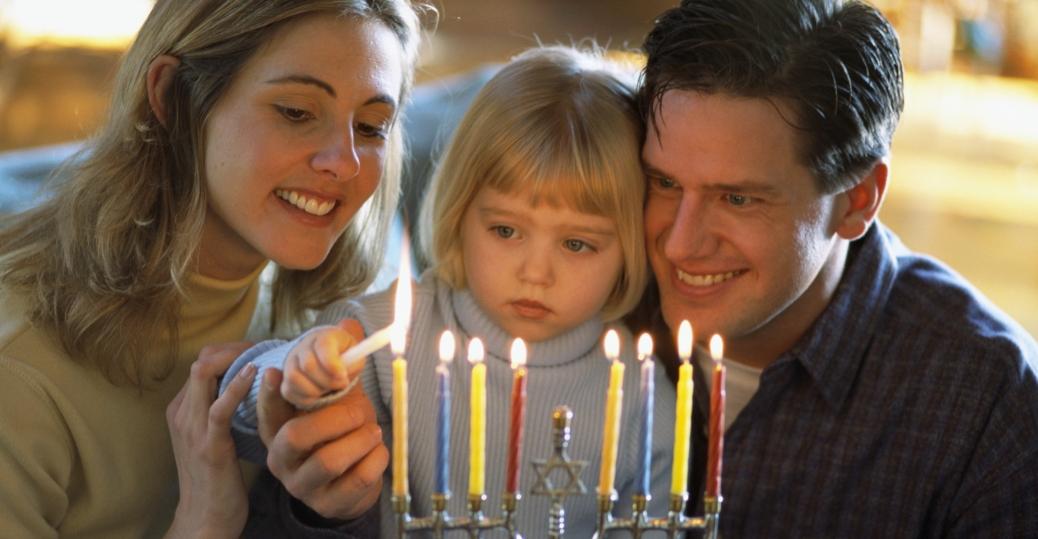 hanukkah menorah eight nights of hanukkah candles shammash holidays jewish  sc 1 th 162 & family-lighting-menorah-2 - Hanukkah Pictures - Hanukkah - HISTORY.com