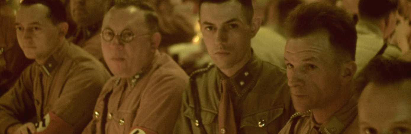Waffen SS (or Schutzstaffel) officer cadets sit at a long table during a Christmas party