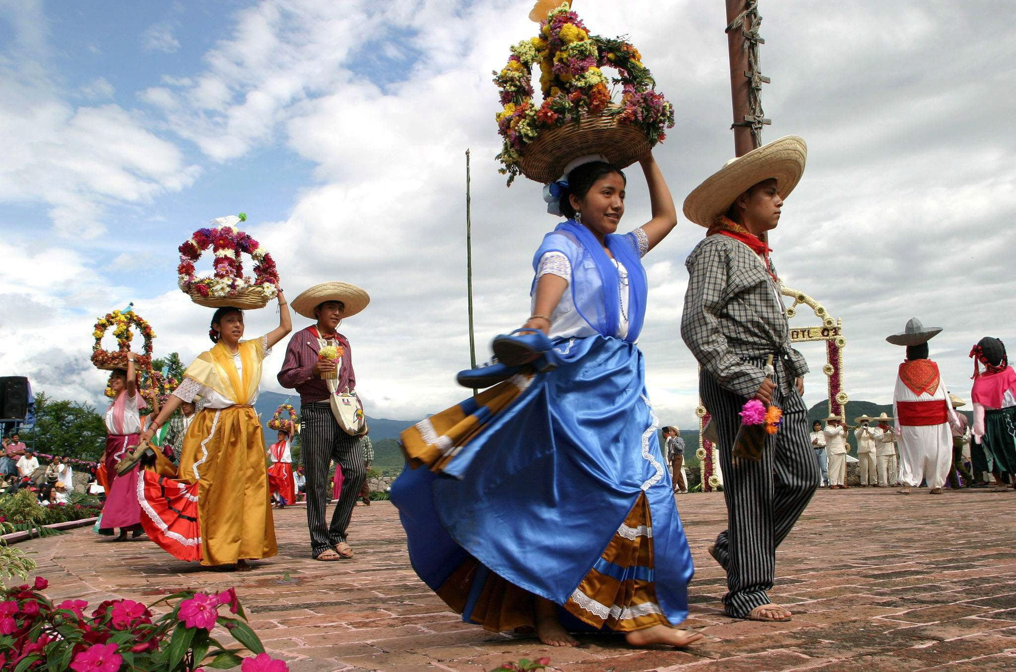 atlixquences women and mexican charros march puebla pictures
