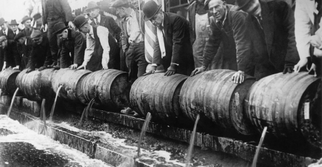 prohibition, anti-prohibition, ban on alcohol, 1919, u.s. government, 1933, al capone, bootlegging operations, police emptying kegs, authorities emptying beer