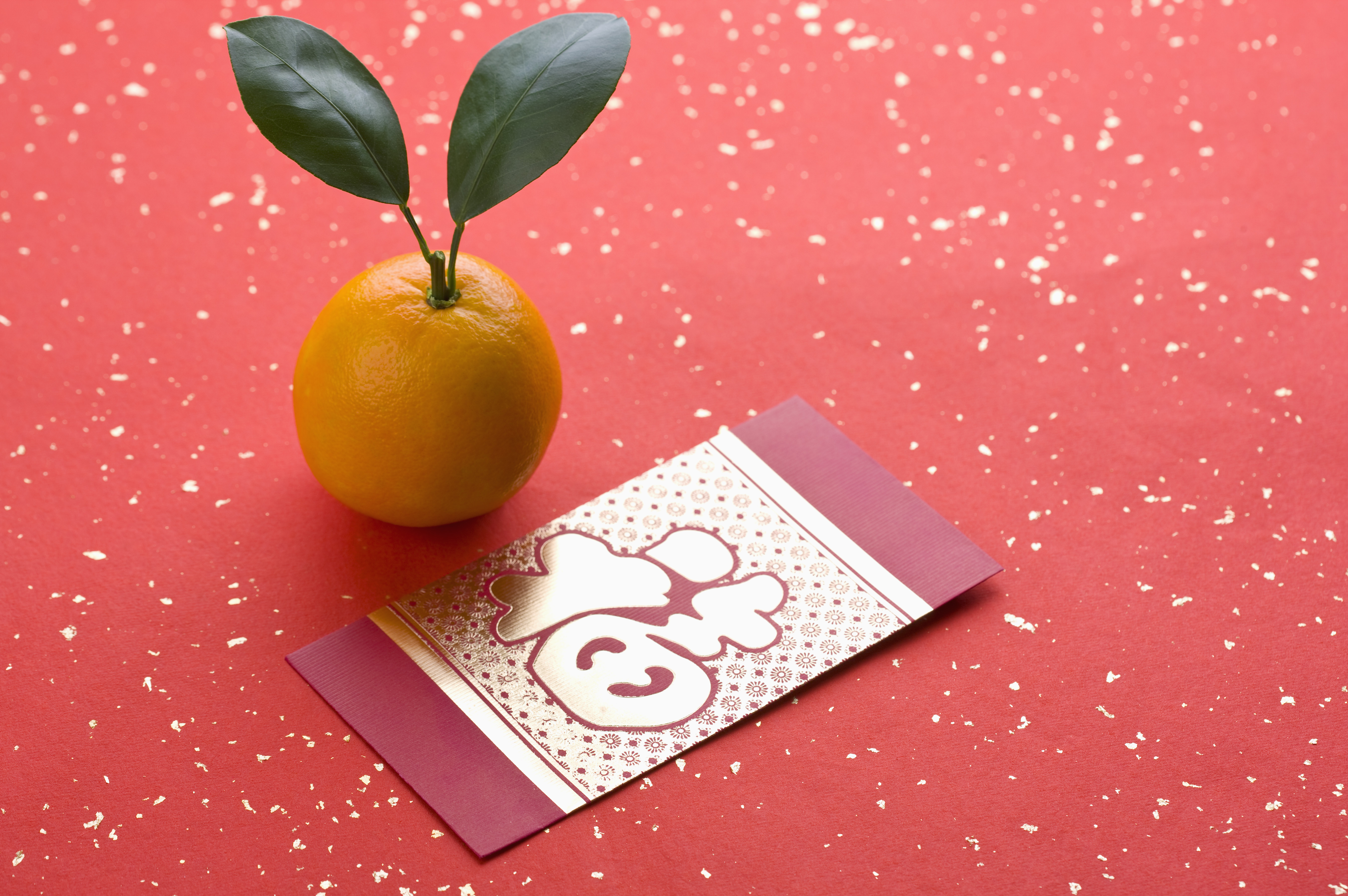 Red envelope and an orange 2 chinese new year pictures chinese chinese new year new year traditions red envelopes oranges good luck buycottarizona Images