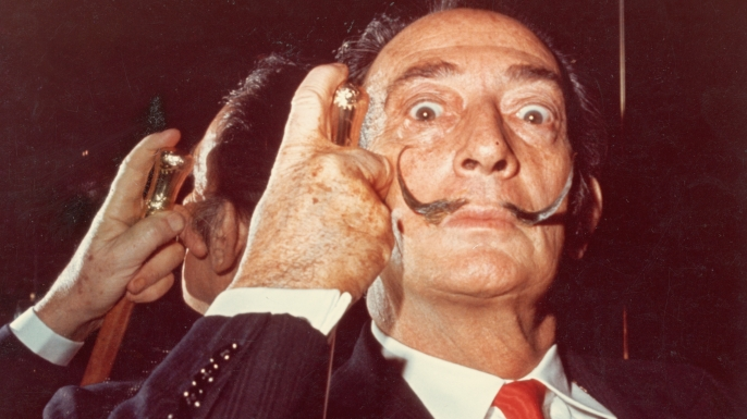 list 8 Historical Figures with Unusual Work Habits Salvador Dali Holds His Cane