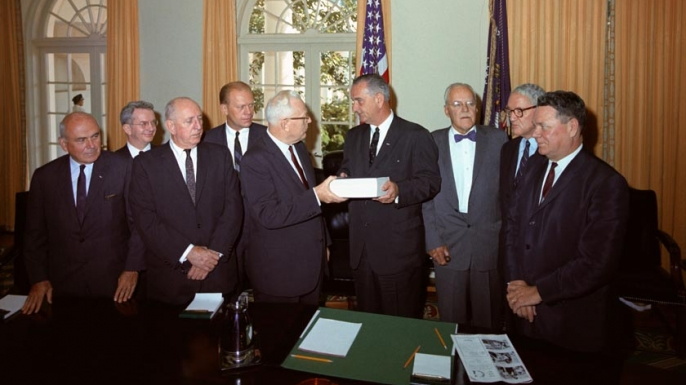 The Warren Commission presents it finding to President Lyndon Johnson.