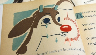 "A first edition of ""Rudolph, the Red-Nosed Reindeer"" (bottom) and an original layout (top)"