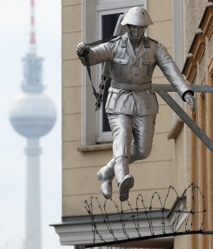 A statue of East German soldier Conrad Schumann, who famously jumped across barbed wire into West Berlin in 1961 (Credit: Sean Gallup/Getty Images)