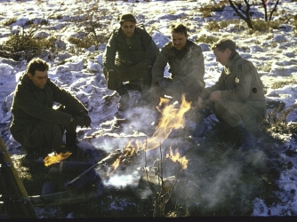 Soldiers of the 1st Army huddle around a campfire in the northern Ardennes Forest (Credit: George Silk/LIFE Picture Collection/Getty Images)