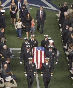 Taya Kyle and her two children follow the casket of her husband Chris Kyle after the funeral at Cowboys Stadium, February 11, 2013 (Credit: Max Faulkner/Fort Worth Star-Telegram/MCT via Getty Images)