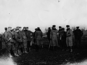 """British and German troops meet in """"No Man's Land"""" during the truce (Credit: Robert Hunt/Windmill Books/UIG via Getty Images)"""
