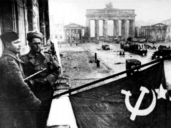 Soldiers hoist the Soviet flag over Berlin