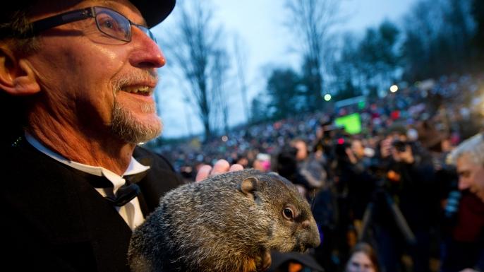 A groundhog handler holds Punxsutawney Phil after his 2012 weather prediction in Punxsutawney, Pennsylvania.