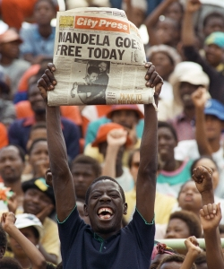 A Sowetan holds up a newspaper announcing Mandela's release. (Credit: Trevor Samson/AFP/Getty Images)