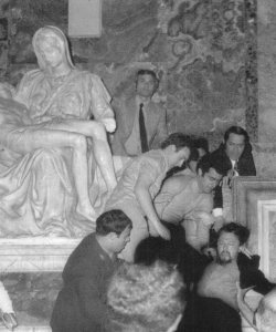 """Laszlo Toth being removed from the Vatican after vandalizing the """"Pieta"""""""