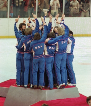 Team USA celebrates on the medal podium after winning the gold with a victory over Finland on February 24, 1980. (Credit: Robert Riger/Getty Images)
