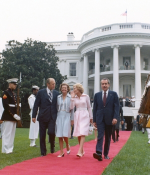 The Nixons walking with the Fords as they leave the White House