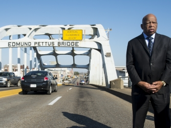 """Rep. John Lewis stand on the Edmund Pettus Bridge in Selma, Alabama, nearly 50 years after the brutal events of """"Bloody Sunday."""""""