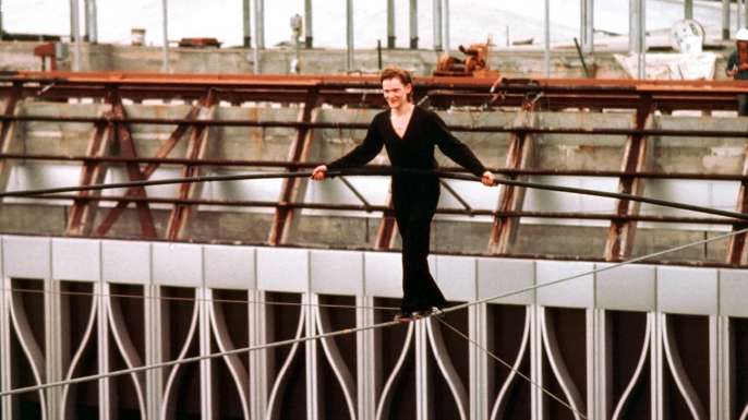 French aerialist Philippe Petit walks on a cable suspended between the not-yet-completed twin towers of the World Trade Center, August 7, 1974