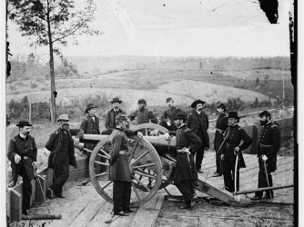 William T. Sherman (center, with arm on cannon) surveys the field during the siege of Atlanta.
