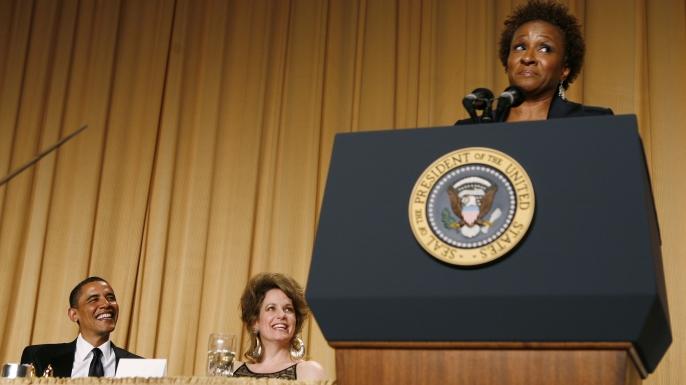 President Barack Obama and journalist Jennifer Loven listen to comedian Wanda Sykes at the White House Correspondents' Dinner in 2011.