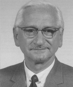 Dr. Albert Sabin and a poster promoting Sabin's oral polio vaccine.