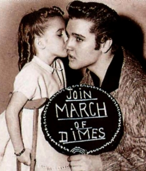 Elvis Presley makes an appearance in support of the March of Dimes, 1950s.