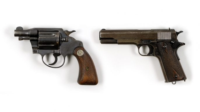 Bonnie Parker's gun (left), found taped to her thigh after her death and Clyde Barrow's gun, found inside his waistband after his death.