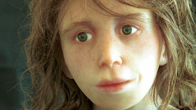 Reconstruction of a Neanderthal child. Scientists think some Neanderthals had red hair, pale skin and freckles.