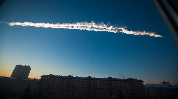 A meteorite contrail streaks across the sky over Chelyabinsk on February 15.