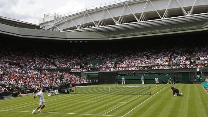 Defending champion Novak Djokovic plays against Juan Carlos Ferrero on the first day of the 2012 Wimbledon Championships