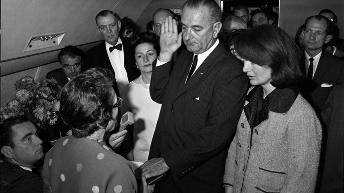 Judge Sarah T. Hughes administers the oath of office to Lyndon B. Johnson aboard Air Force One on November 22, 1963. (Credit: Universal History Archive/Getty Images