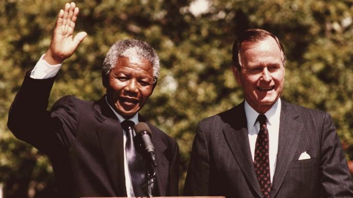 Nelson Mandela and President George Bush greet the press on June 25, 1990.
